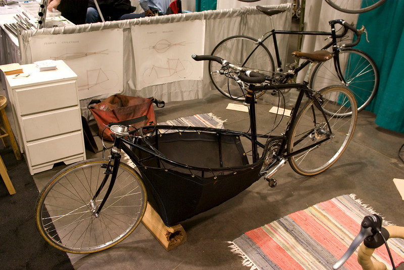 A side view of the bicycle.  The owner rides with her dog in the cargo area.  It was nice to see a well used bicycle on the show floor.