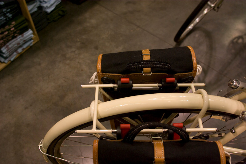 Stainless protection for pannier hooks