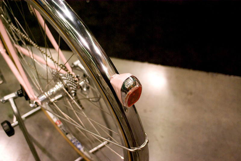 Fender mounted battery light, automatically turns on when the bike is moving in the dark.  Painted to match the bike.