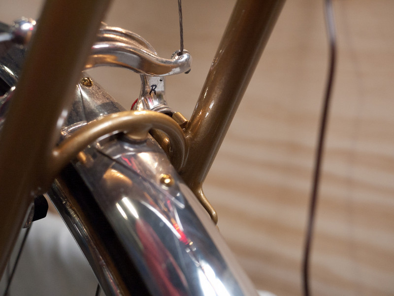 There is more going on with Peter's bridges than I had realized.  He brings the curved bridge down behind the centerpull studs to give the studs more support against the seatstays.