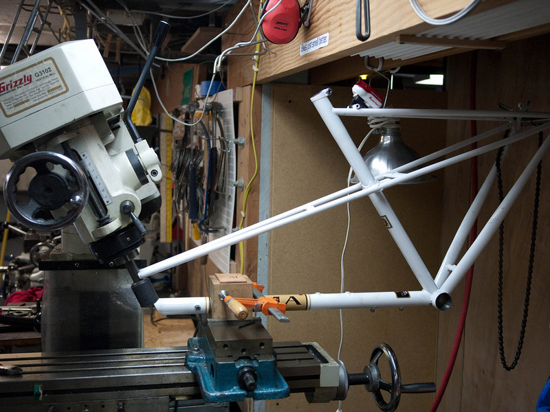 This is how I mitered the downtube.  I mitered the mixte stays using a file.  The angle in this photo isn't quite right (you can see that the seat tube is steeper than the milling head), but it lets you see how the frame was mounted at least.
