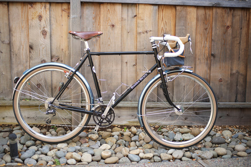 """Build list:<br /> • Boulder All Road (56cm stock geometry/size)<br /> • White Industries VBC crank (46/32) with SKF bottom bracket and 12-30 Ultegra cassette<br /> • XTR M960 rear dérailleur, CX70 front dérailleur, with Dura Ace 7900 downtube shifters<br /> • Velocity A23 650B rims (offset spoke rear), polished with Dura Ace 7700 rear hub, Schmidt XS100 dynamo hub, Sapim Laser spokes and Dura Ace 7700 skewers<br /> • Grand Bois Hêtre Extra Leger tires and Michelin latex tubes<br /> • Berthoud 50mm stainless steel fenders with custom front flap<br /> • Miche 1"""" threadless roller bearing headset<br /> • Nitto 626 seatpost with Brooks Ti B17 saddle<br /> • IRD threadless stem with Nitto mod 177 """"Noodle"""" handlebars<br /> • Cane Creek SCR-5 brake levers with Avid Tri-Align cantilever brakes (Ti fortified)<br /> • Nitto M12 front rack with Schmidt Edelux light<br /> • Nitto """"T"""" bottle cages<br /> • Cateye """"Adventure"""" cyclocomputer<br /> • Time RXS """"Speed"""" pedals"""
