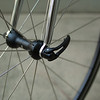 "Campagnolo Nucleon wheels with newer black Campagnolo Record skewer.  Yay, this Colnago has no stupid ""lawyer lips""!"