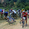 One of the few images of me racing.  I'm usually the photog but this was one of those rare moments when I'm at the other end of the lens.  I'm #75 to the left and this was when the race was first flagged off at Bukit Timah Nature Reserve.<br /> <br /> I was not at all successful in MTB races.  I was probably fit enough to place but always had severe reservations about bombing downhill at breakneck speeds.  I particularly remember making up several places going uphill, just to lose them all (and more) going downhill.  If there's an all-uphill MTB race, I would probably do well! :)
