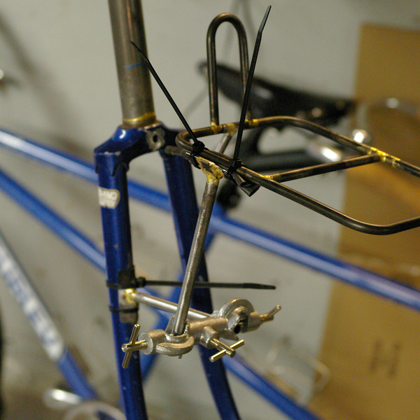 In this shot you can see that the rack is well supported just by the jig.  The centerbolt of the rack is no longer in the fork crown.