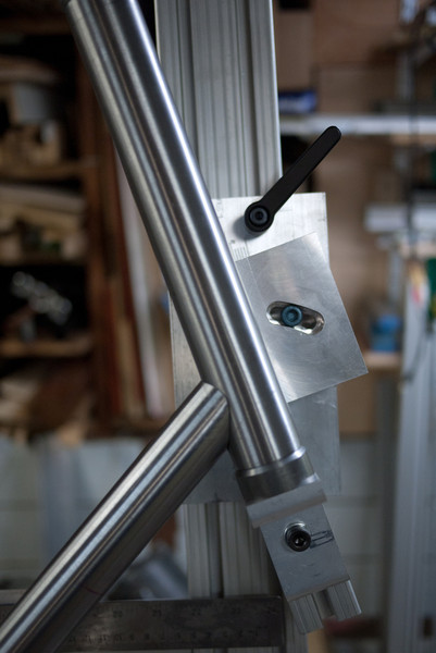 The HTA tower assembly pivots around the bottom of the head tube.  The blue bolt locks the angle, the black handle allows the plate to move up and down.