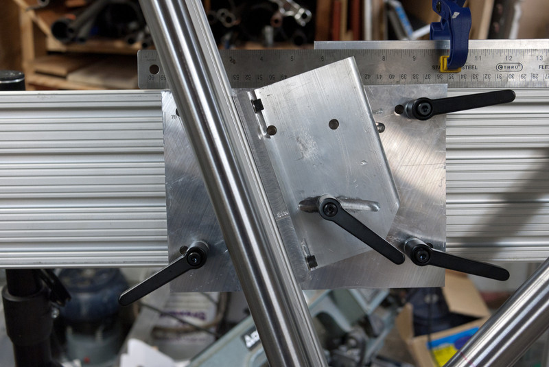 The STA tower assembly pivots around the BB shell (so adjusting the STA angle does not move the BB shell).  The 3 outer handles move this assembly left and right, the one in the slot is for adjusting the seat tube angle.  There is a scale for reading off the seat tube angle on the other side.