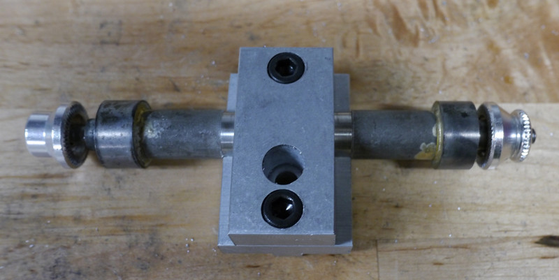 "Put the top of the axle clamp over the dummy axle and secure into place using two 1/4"" x 5/8"" bolts."