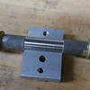 Place the dummy axle (not provided with the kit) into the bottom of the axle clamp.  The center section of the dummy axle should fit precisely into the groove.