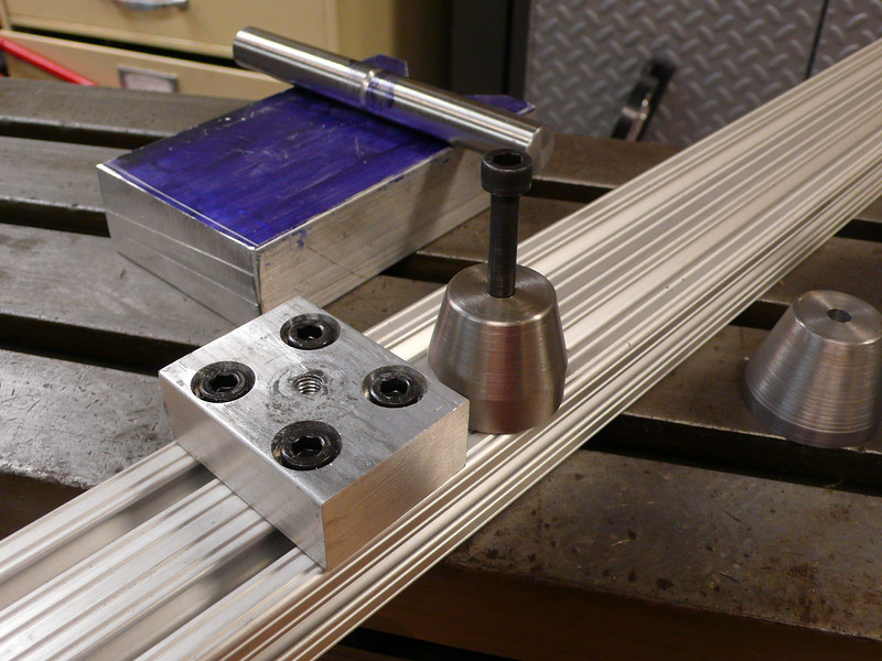 """This is an alignment cone which can slide on 80/20.  I like the idea of the seat tube cone that is in this 80/20 frame jig[1], but I didn't like that it couldn't be adjusted for height.  My cone will mount to the block, which then mounts to a piece of vertical 80/20 extrusion.<br /> <br /> I made this mounting block, but I decided to just buy 80/20 """"manifold"""" blocks for the rest of them.  They are $11 each which seems like a lot for $1.50 worth of aluminum, but it saves me about 45 minutes of work per block and I need 4 of them total (two for the head tube, one for the seat tube, one for the bottom bracket).<br /> <br /> [1] <a href=""""http://www.instructables.com/id/SPHE0MXF1JZQZZZ/"""">http://www.instructables.com/id/SPHE0MXF1JZQZZZ/</a>"""