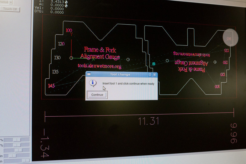 The software that operates the mill is waiting for me to change the tool.