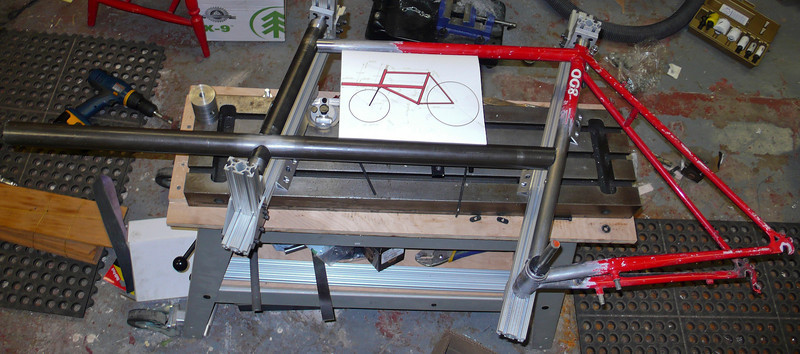 The head tube and cargo tube have been mitered and are mounted on the front triangle fixture along with the donor frame.
