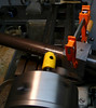 """Mitering on the lathe.  I built a guide for doing this miter, it is a 2.5"""" cubic block of aluminum with a 1.75"""" hole in it.  I mount it instead of the toolpost on the lathe."""