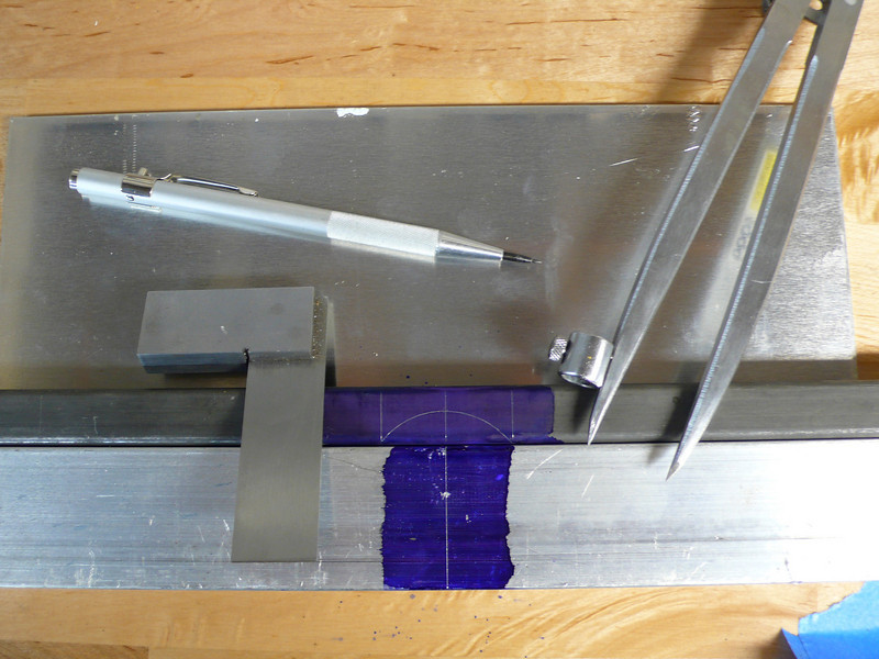 Scribing the miter on the support bars.  I used a block of aluminum with a small hole punched in it as a gage.
