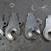 A series of prototype dropouts.  L->R: modified Pacenti, slot too deep, slot too shallow and too chunky looking, final design.  <br /> <br /> The third one is rough from using a dull HSS cutter.
