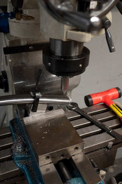 Aligning the milling machine with the center of the miter.