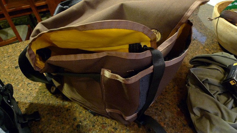 The straps can hook to the bottom when the bag is overfull.