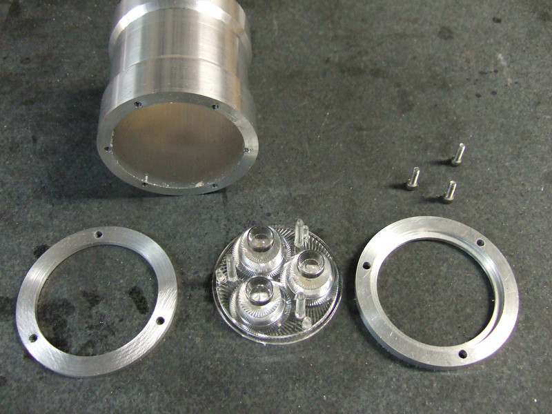 Lens holding components of the headlight housing.
