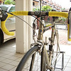"""The """"Fondriest"""" in my parent's car porch in SIngapore.  As per Armstrong and Pantani, the front derailleur was actuated by a downtube shifter and the rear derailleur was actuated by an STI brifter.  The right brifter was also a gift from Kenneth; one day he was clearing out some boxes at Cycleworx and he found just one right brifter.  """"You want?"""" he asked.  Obviously!"""