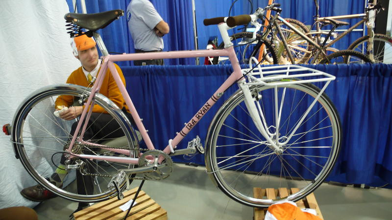 Ira Ryan in Pink - Pink is the new black. Pink bikes and components were a major theme at this year's show. Ira Ryan joins the party, sporting some nice fenders and a really big rack.