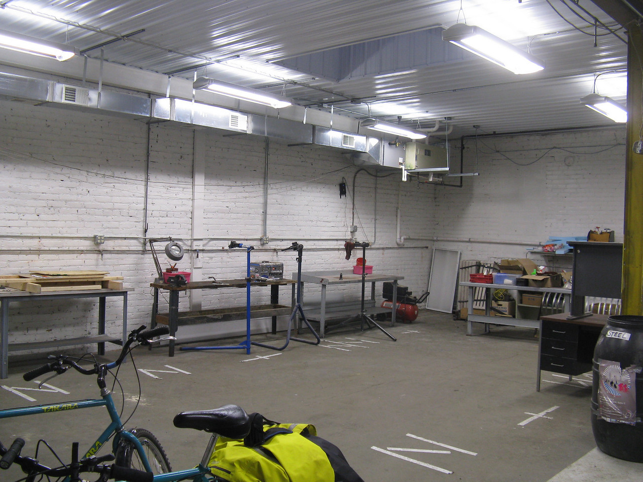 The brightly lit member's shop, complete with skylight.  More benches complete with tools on pegboards have not been finished yet.