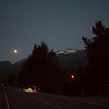Riding under a nearly full moon by headlights and enjoying fading views of the mountains