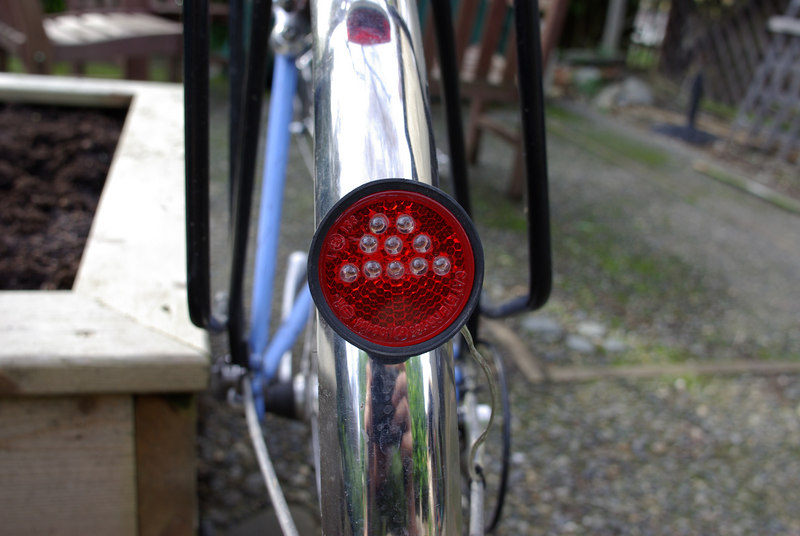 Taillight on fender.  The LEDs are all near the top because there is less space inside the reflector body near the bottom.