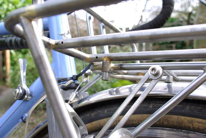 """Another closeup of the """"spigot"""" interface between the porteur rack and the handlebar bag rack.  The porteur rack has 3 studs which fit into sleeves on the handlebar bag rack."""