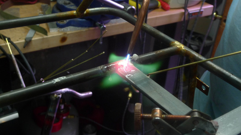 Lee brazes in a sign support on his rack.  Shot through didynium glasses, without that you'd see a huge orange cloud instead of through the flame to the metal.