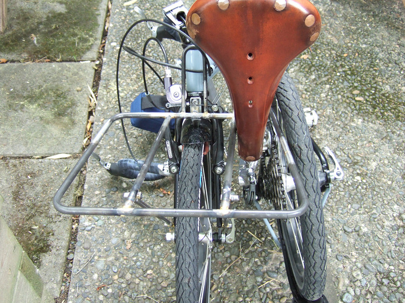 The rack mounted and the bicycle folded.  The rear tire sits very close to, but doesn't touch, the rear rack.  The saddle fits into the rear left corner of the rack.