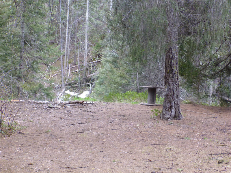 Campsite with a cable spindle as a table.  This would be tough to access by motor vehicle now.