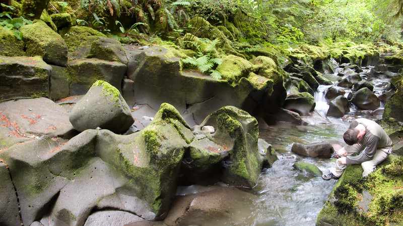 Filtering water on Curly Creek.  The lava has been eroded by water into very interesting formations.