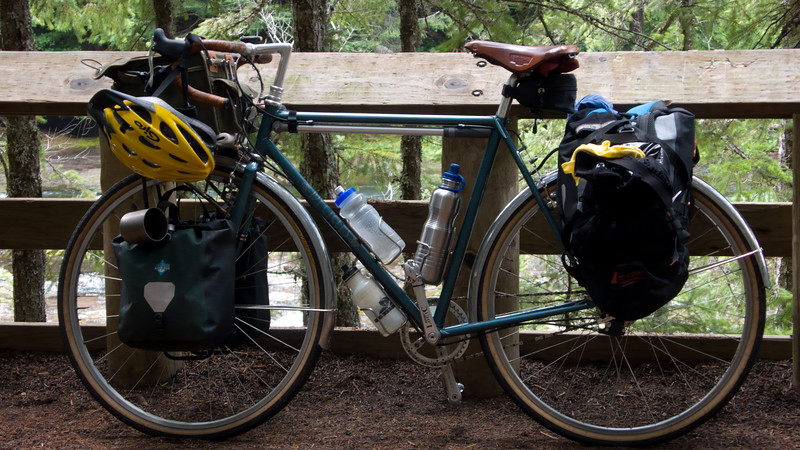 My bike with many thngs strapped onto it.