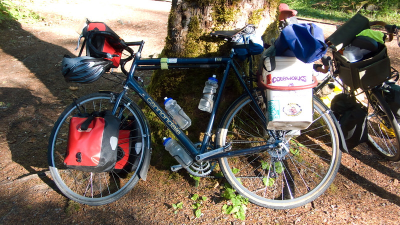 Larry's touring load.  Rear buckets, front panniers, a small handlebar bag, and his huge sleeping pad strapped across the back.
