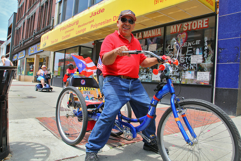 Jorge Rivera of Fitchburg was on Main Street with his bike that was decked out with an American Flag and a Puerto Rican on Monday afternoon. SENTINEL & ENTERPRISE/JOHN LOVE