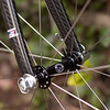 "American Classic ""Micro"" front hub (20-hole) with Kinlin XR-200 rims, DT Revolution spokes, and DT alloy nipples.  Built by yours truly when I was bored.<br /> <br /> Since the AM hubs did not come with skewers, I threw on a pair of Campagnolo Record skewers.  They look quite fetching and are appreciably light!  I don't have a scale (recovering weight weenie) so I don't know how light.  I can easily feel the difference between these and my Aerohead/Record/Revolution wheels though."