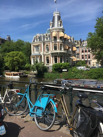 Blue bike,  canal boats, grand architecture, Amsterdam, The Netherlands