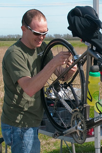Bike Mechanic James, works on a BP MS 150 Ride Marshal's wheels.