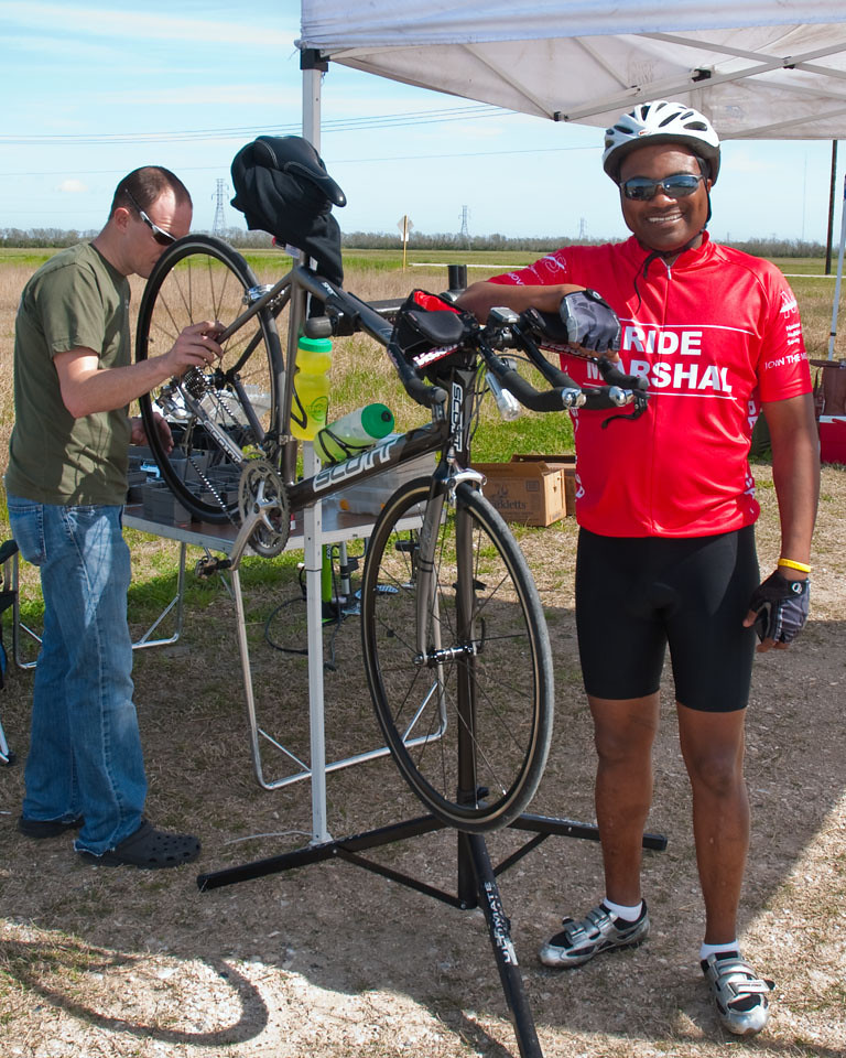 A happy and proud Ride Marshal poses with his ride as James makes the finishing touches to his work.