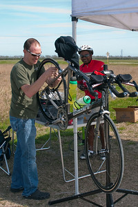 Bike Mechanic James, works on a BP MS 150 Ride Marshal's wheels.