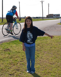 Natalia went out to the road and did duty as the RS4 flagperson calling out to riders to turn in to the rest stop.  She and her sister later added a chair and a handmade sign to help direct riders.