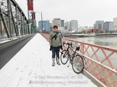 Jeremy and his bike on the Hawthorne Bridge. #snowday