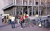 4*Sun, Mar 5, 1972<br /> People: Gunter Hamersbach(legs crossed), Ken Leitch(helmet, yellow),Patty Rose(dark green,<br /> Subject: assemble for bike ride<br /> Place: Bancroft / Telegraph, Sproul Plaza<br /> Activity: <br /> Comments: