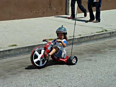 this kid was crankin' away on this big wheel. He went many miles at full blast.