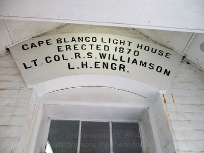 A sign describing the lighthouse's erection.