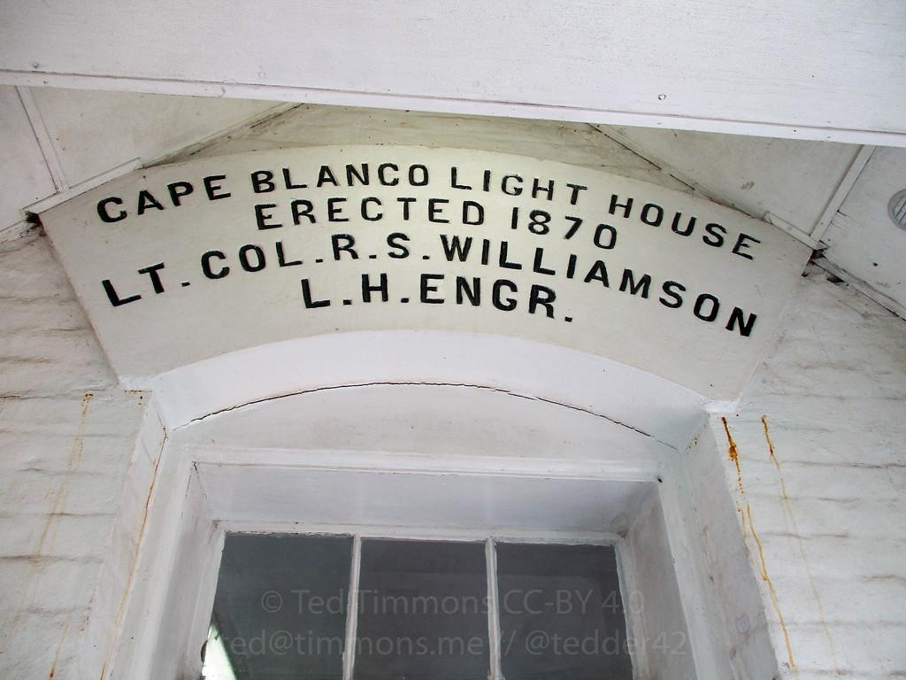 A sign describing the lighthouse's erection.
