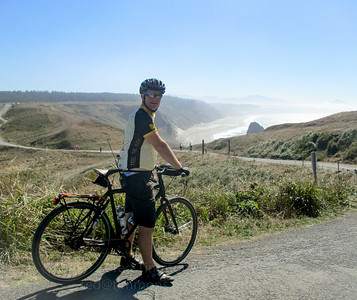 Jeremy, riding on the access road back to the Cape Blanco parking lot (visible in the distance).