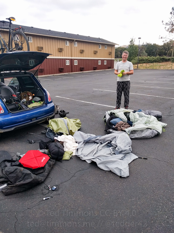 We left for the hospital in a hurry, so we unloaded everything in a parking lot so we could actually pack our tents and bags instead of just stuffing them.