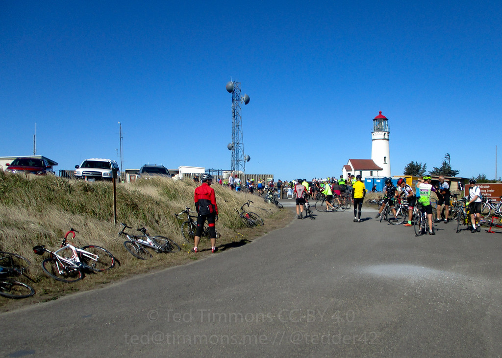 Cyclists gathering near the lighthouse.