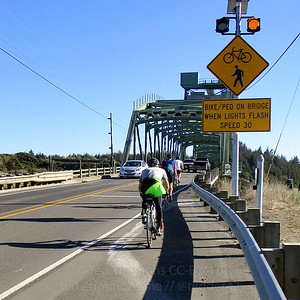 Riding into Bandon, across the Bullards Bridge, which crosses the Coquille River.